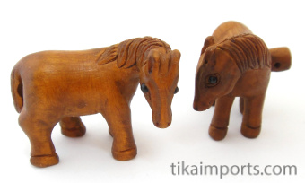 handcarved boxwood horse buttons, showing two pieces
