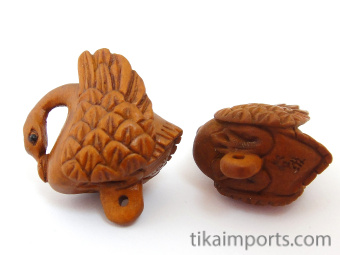 handcarved boxwood swan buttons, showing two pieces