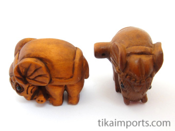 handcarved boxwood elephant buttons, showing two pieces