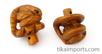 handcarved boxwood snake buttons, showing two pieces