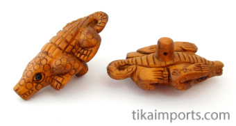 handcarved boxwood alligator buttons, showing two pieces