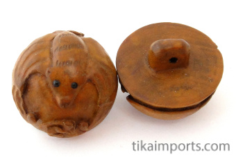 handcarved boxwood bat buttons, showing two pieces
