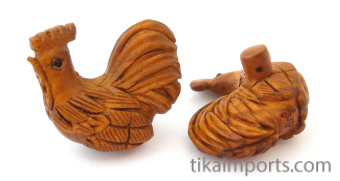 handcarved boxwood rooster buttons, showing two pieces