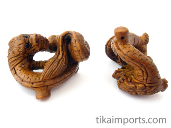 handcarved boxwood dragon buttons, showing two pieces