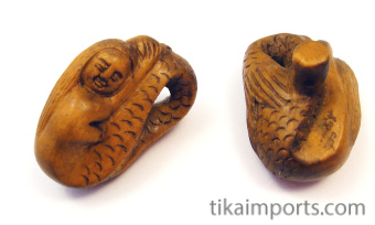 handcarved boxwood mermaid buttons, showing two pieces