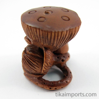 handcarved boxwood ojime bead of frog with lotus blossom