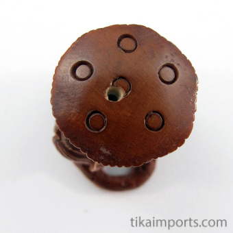 handcarved boxwood ojime bead of frog with lotus blossom, showing bead hole
