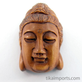 handcarved boxwood ojime bead of Quan Yin