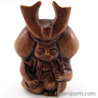 handcarved boxwood ojime bead of samurai