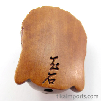 handcarved boxwood ojime bead of Buddha showing hole from top to bottom