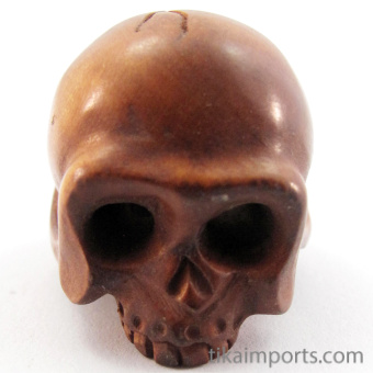 handcarved boxwood ojime bead of skull