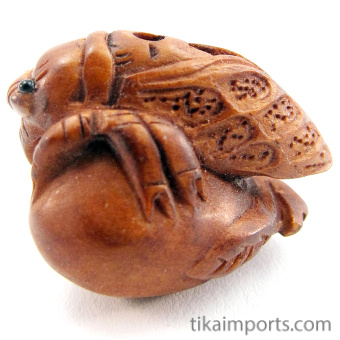 side view of handcarved boxwood ojime bead of cicada