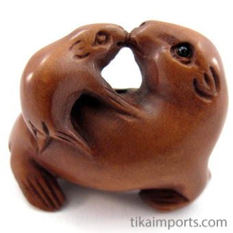 handcarved boxwood ojime bead of seal
