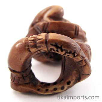 bottom view of handcarved boxwood ojime bead of frog on lily