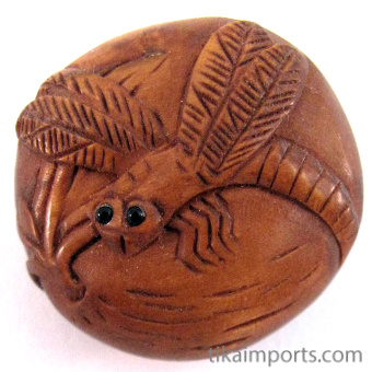 handcarved boxwood ojime bead of dragonfly