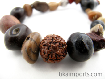Assorted seeds and seed pod beads, strung into a stretch bracelet with elastic cord