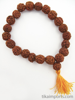 Natural rudraksha seed beads, strung into a stretch bracelet with elastic cord and tassel