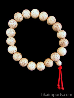 White lotus seed beads, strung into a stretch bracelet with elastic cord