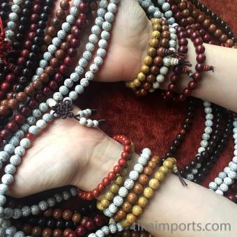 10pc assortment of Lotus Seed mala strands along side a 10pc assortment of lotus seed bracelets