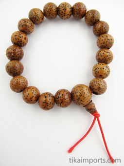 Brown lotus seed beads, strung into a stretch bracelet with elastic cord