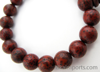 Red lotus seed beads, strung into a stretch bracelet with elastic cord