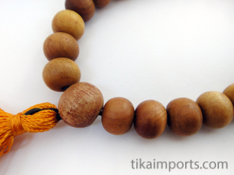 Naturally fragrant 10mm sandalwood beads, strung into a stretch bracelet with elastic cord and tassel