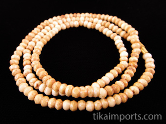 closeup of 3mm tea-stain bone necklace shown on black background