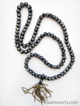 Prayer bead mala strand of 108 batik bone beads with the sanskrit symbol 'Om'