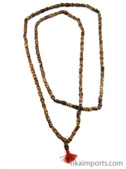 Prayer bead mala strand of 108 dark carved bone skull beads