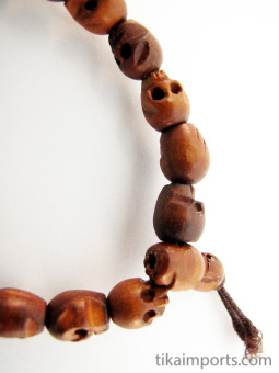 Original handcarved wood skull beads strung into a stretch bracelet with elastic cord