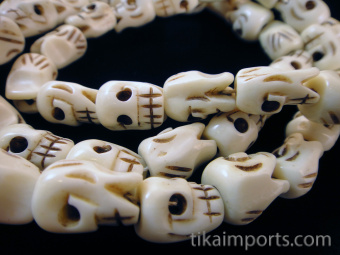 cPrayer bead mala strand of 54 fancy carved bone skull beads