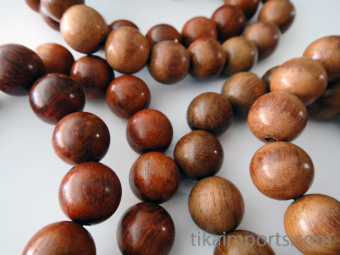 12mm naturally aromatic palisander rosewood beads, strung into a stretch bracelet with elastic cord and hand knotted tassel