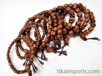 Wood Skull Mala Bracelets- showing variety in a typical 10pc assortment