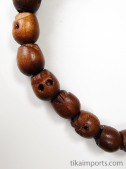 Small handcarved wood skull beads strung into a stretch bracelet with elastic cord