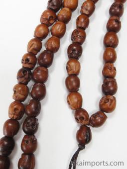 Prayer bead mala strand of 108 carved small wood skull beads
