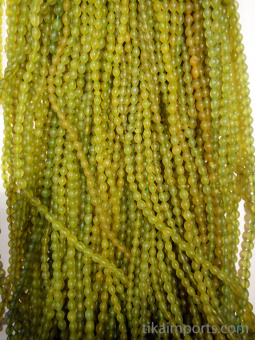 Prayer bead Tespeh strand of 99 handcarved green serpentine stone beads, showing color range