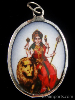 Durga, the mother aspect of Kali, shown sitting astride her mount, the lion, an animal who is both ruthless, and gentle towards her young.