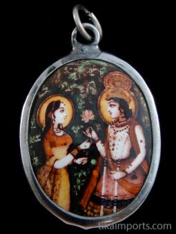 Rama, the incarnation of Lord Vishnu in Hindu Mythology, presents a lotus blossom to his wife Sita.