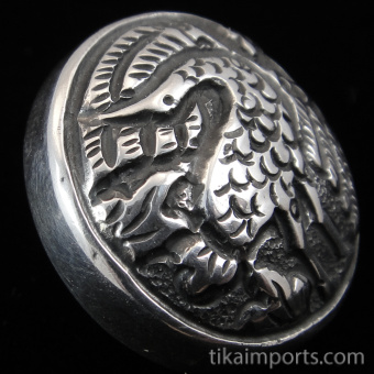 sterling silver repouse shank-button with bird of paradise design