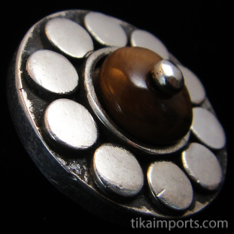 side view of sterling silver repouse shank-button with Shell Flower design