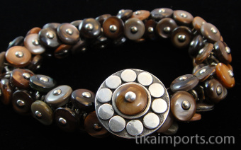 sterling silver repouse shank-button with Shell Flower design shown strung on a fancy boot button stretch bracelet