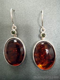 Sterling silver earrings featuring amber with peridot accent stones.