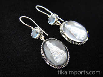Sterling silver earrings featuring quartz crystal carved with the image of Quan Yin and aquamarine accent stones
