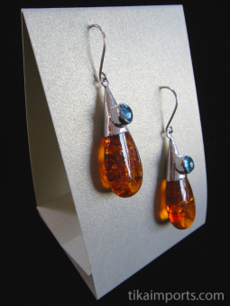 Sterling silver earrings featuring amber drops with a variety of accent stone options