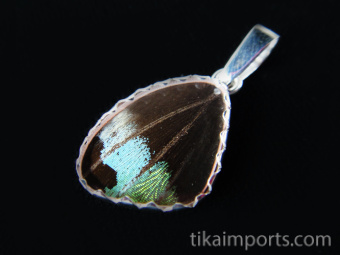 Reverse view of Tiny Rainbow Sunset (Urania rhipheus) Shimmerwing pendant with butterfly set in sterling silver
