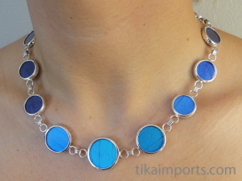 view of Blue Round Shimmerwing necklace on model