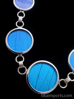 Closeup of blue round Shimmerwing necklace