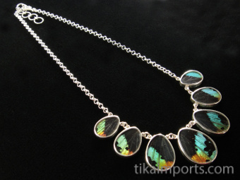 Sunset Moth (Urania rhipheus) Shimmerwing necklace with graduated teardrop-shaped wings set in sterling silver with adjustable chain