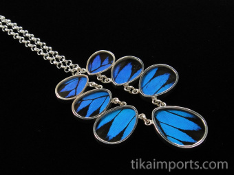 Small Blue & Black (Papilio ulysses) Shimmerwing necklace with graduated teardrop-shaped wings set in sterling silver with adjustable chain