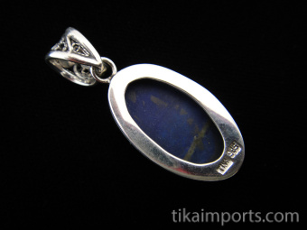 Sterling silver pendant featuring lapis stone with decorative filigree bail